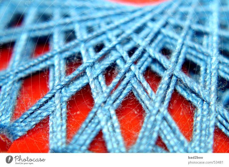 Zwirn 02 Nähgarn Nähen Stoff binden Schnur gekreuzt Faser gewebt Textilien Material Naht Stern (Symbol) wickeln blau orange Spinne spinnen genäht thread yarn
