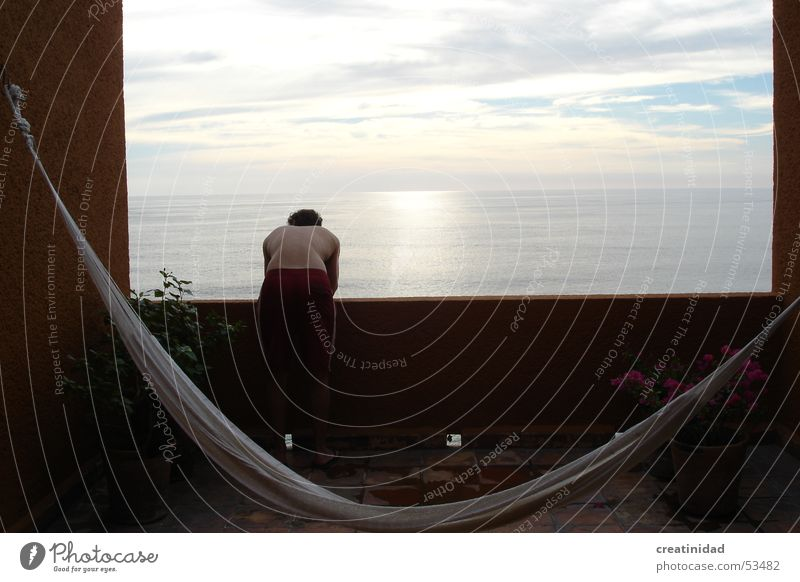 z en ixtapa Himmel Sommer Swing Erholung Wasser Physik Ixtapa sky clouds sun terrace balcony boy man back sunrise view hamac calm sea ocean water orange color
