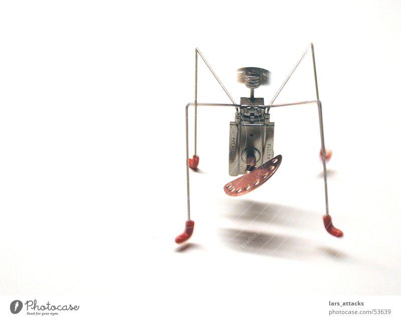 Stahlspinne Windböe Spielzeug Drehung Geschwindigkeit Mechanik Schwerkraft Feder unruhig Bewegung fliegen Fuß Metall rote füße