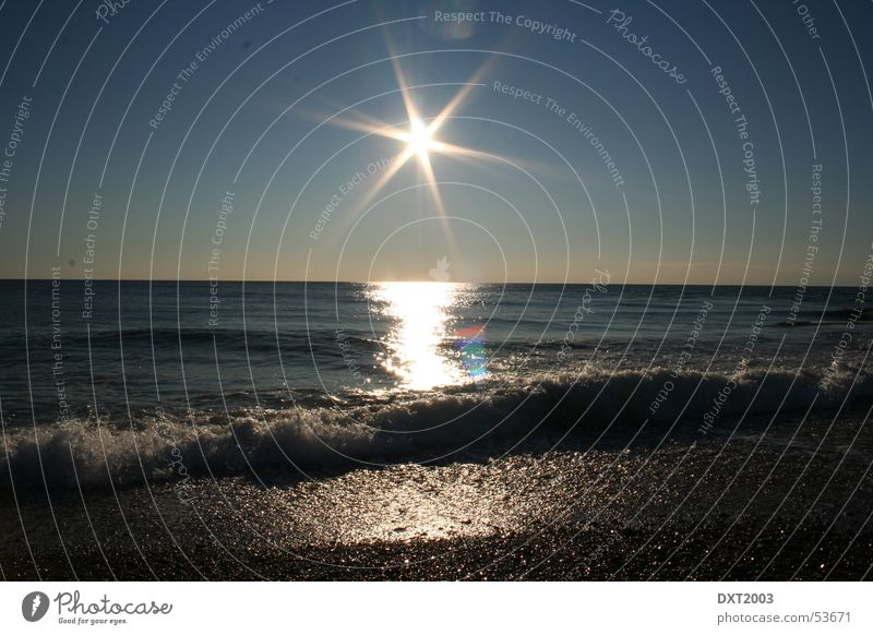 Sunset Beach Wasser Sonne Meer Strand Wellen brechen Kies Brandung grell