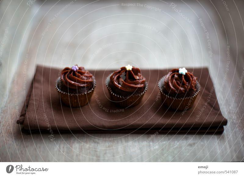 zu dritt Kuchen Dessert Süßwaren Schokolade Ernährung Slowfood Fingerfood lecker süß braun 3 Cupcake Kalorienreich Farbfoto Gedeckte Farben Innenaufnahme