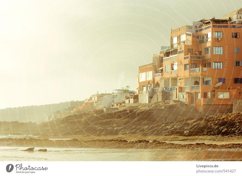 Marokko Himmel Natur Ferien & Urlaub & Reisen Wasser Sommer Sonne Meer Landschaft Haus Strand Umwelt Wärme Küste Stein Felsen orange