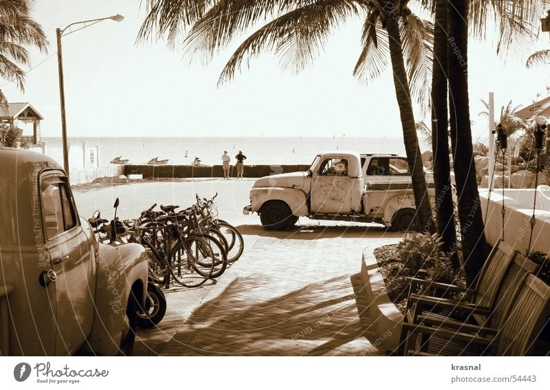 key west beach retro Strand old car Sepia Palme tranquility bicycles chairs calm ocean