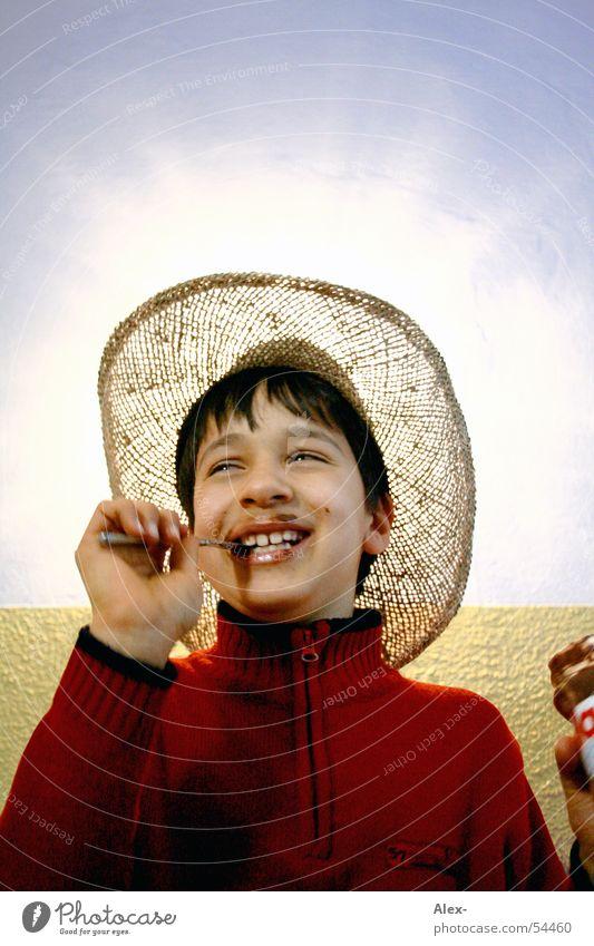 Choco-light Freude Ernährung Junge lachen Beleuchtung klein Fröhlichkeit süß Cowboy