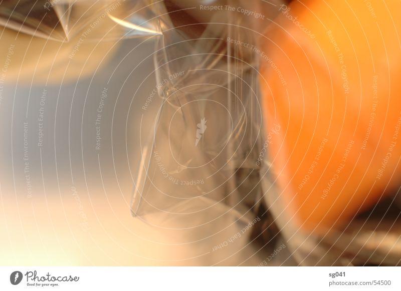 eingepackt weiß braun orange frisch Süßwaren durchsichtig einpacken Folie
