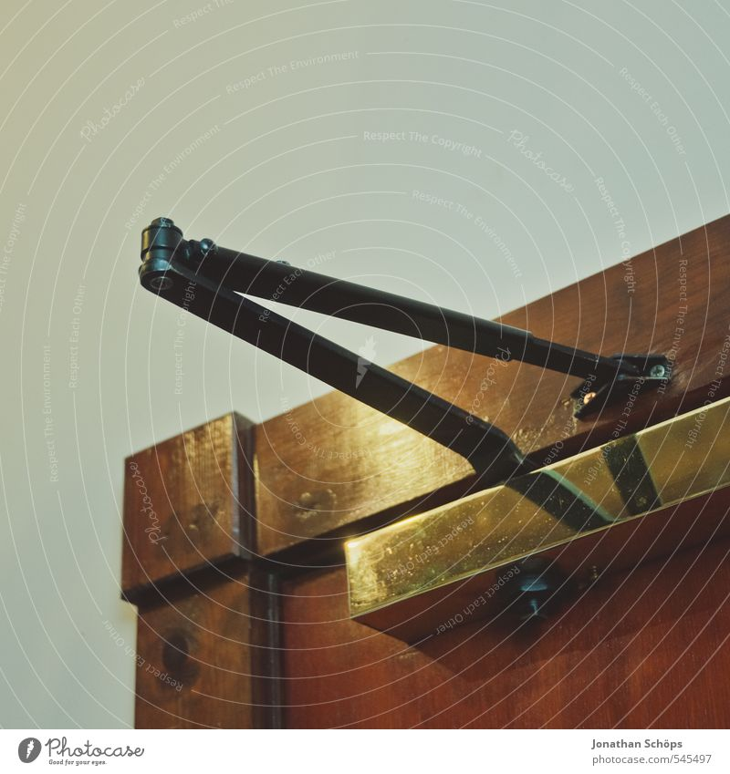 Hostelecke I ruhig Wand Architektur Innenarchitektur Raum gold Tür ästhetisch Ecke einfach eckig kahl minimalistisch langsam Herberge Holztür