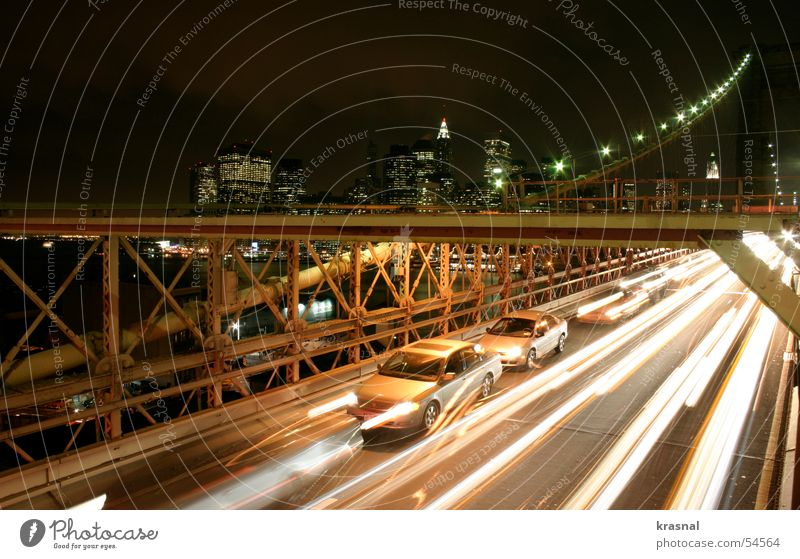 Brooklyn Bridge Manhattan Stadt beige Hochhaus bridge blur night construction cars big capitol of the world orange lights traffic street