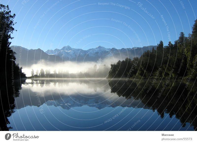 Spiegelsee See Wald Lake Matheson Neuseeland Nebel Wasser Berge u. Gebirge