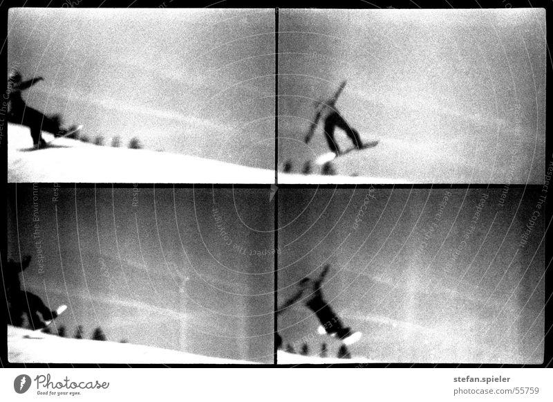Sprung schwarz weiß Snowboard springen Lomografie Winter Skipiste Trick Kick grau Schwarzweißfoto 360 Schnee fallen Himmel Bewegung Außenaufnahme 4 Drehung