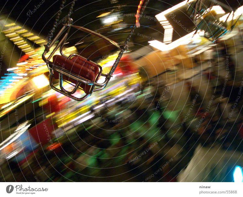Das Kettenkarussell Freude Freiheit Stuhl Jahrmarkt Mensch Luft drehen frei gelb rot Cannstatter Wasen luftig Schwindelgefühl kreisen Sitzgelegenheit Karussell