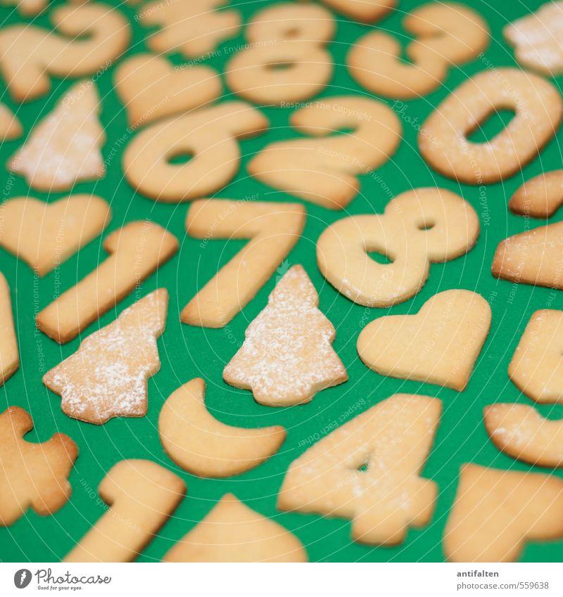 Kekspuzzle I Weihnachten & Advent grün gelb Essen 1 Lebensmittel braun liegen Ernährung Herz Kochen & Garen & Backen süß 3 Zeichen Ziffern & Zahlen