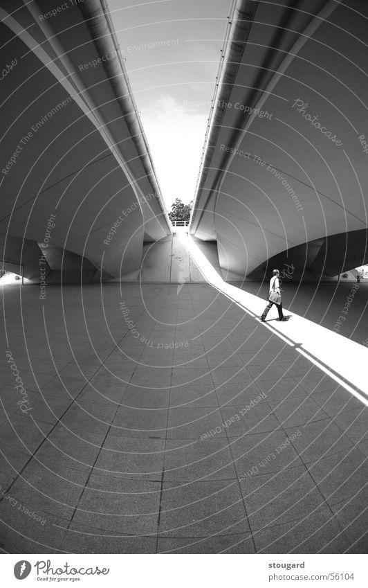 Man in the light under a bridge Licht Design Singapore man walk architect architecture graphic construction shadow