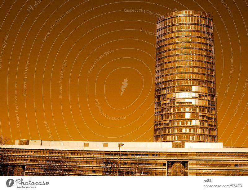 kölle erwacht - Fassadenmaskerade Himmel Stadt Gebäude braun orange Glas Hochhaus modern Turm Reichtum Köln Stahl Köln-Deutz