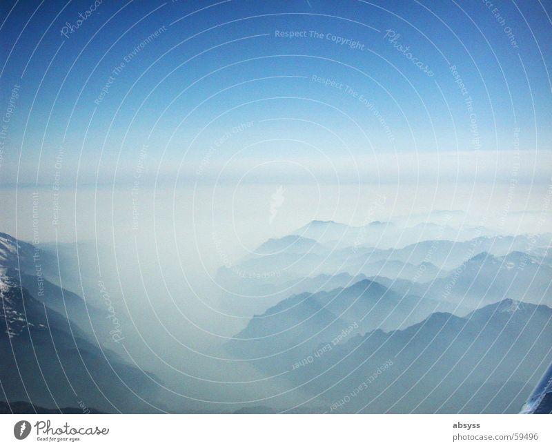 Weitsicht Flugzeug Nebel Alpen Luftverkehr blau Sonne Schönes Wetter