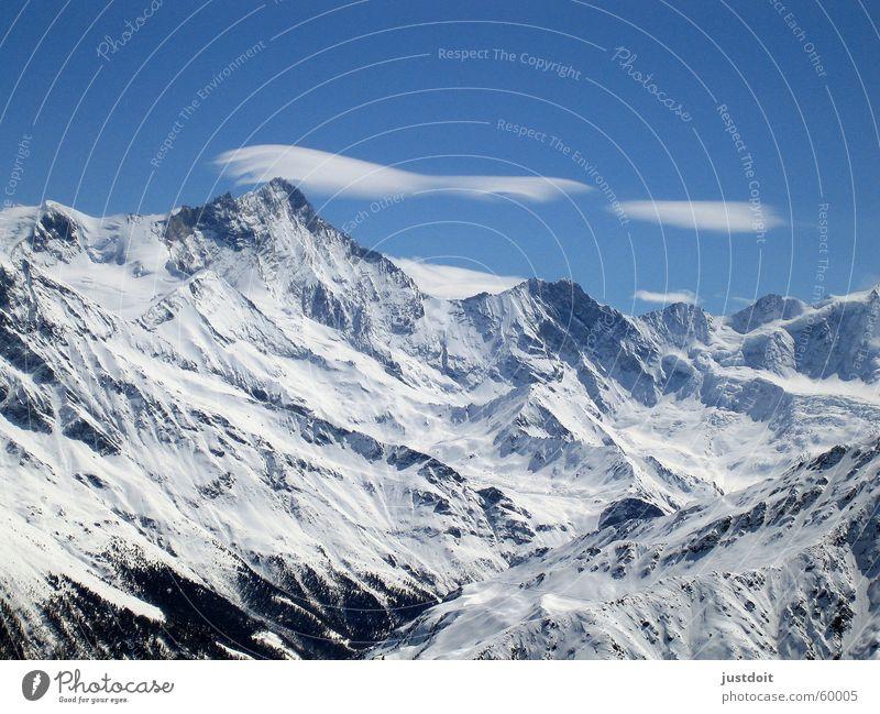Alpentraum Himmel weiß blau Wolken Ferne kalt Schnee Berge u. Gebirge Freiheit träumen Luft Eis Wetter frei leer Schweiz