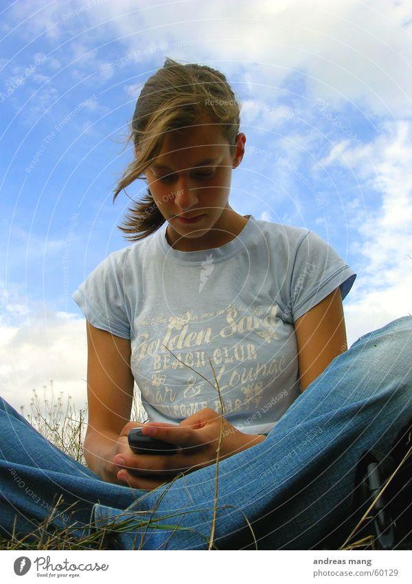Missing him Frau Himmel Telefon Wolken Gras Haare & Frisuren Feld Wind Mensch sitzen schreiben Handy Telekommunikation SMS