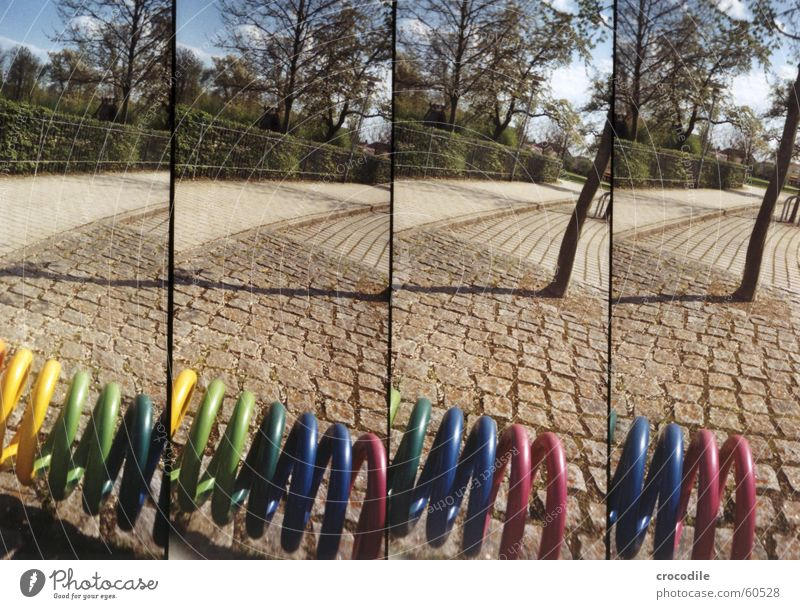 lomokringel mehrfarbig Baum Zaun Wolken grün Lomografie supersampler Straße Himmel blau Schatten
