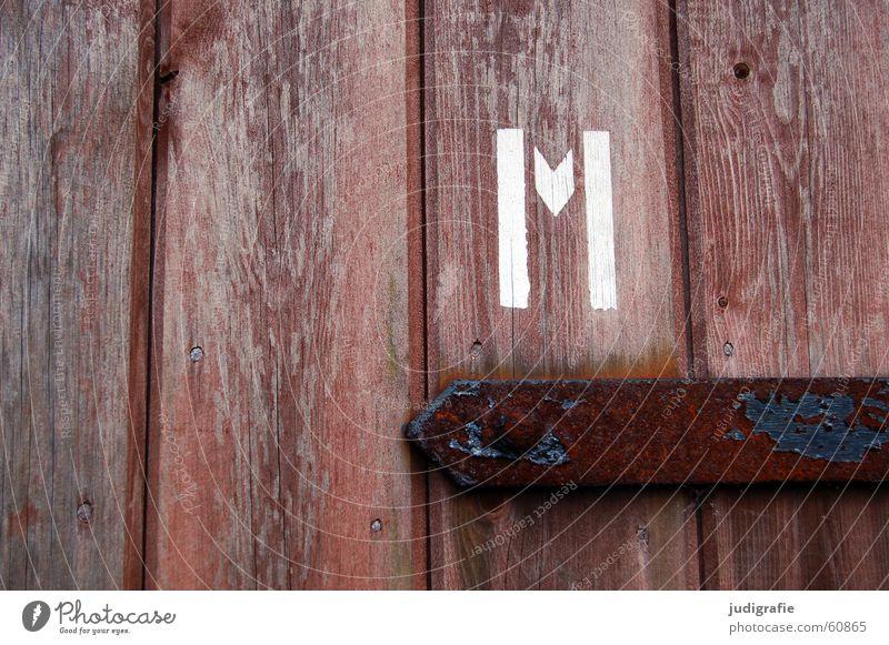 M Buchstaben Typographie Schablonenschrift Holz Holztür Beschläge braun Mann Herr Schraube weiß Detailaufnahme Farbe Schriftzeichen emm Tür Rost Metall Toilette