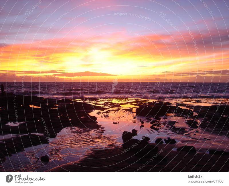 Sonnenuntergang auf Bali Meer Wasser