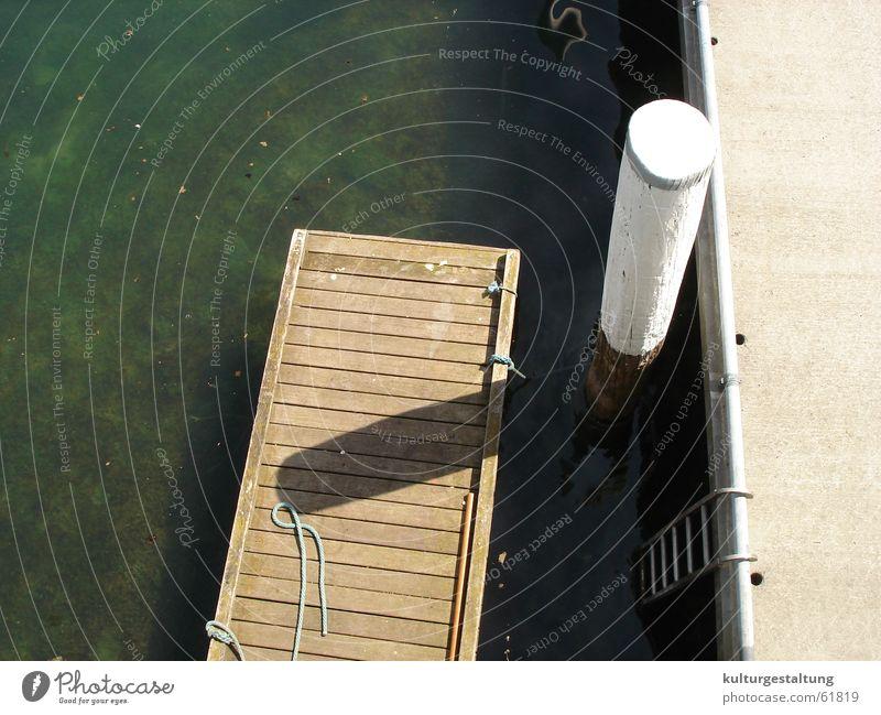 Hafenanleger im Sommer Wasser Ferien & Urlaub & Reisen Meer ruhig Erholung Holz Frühling See Traurigkeit hell Stimmung Wasserfahrzeug Schweiz Anlegestelle