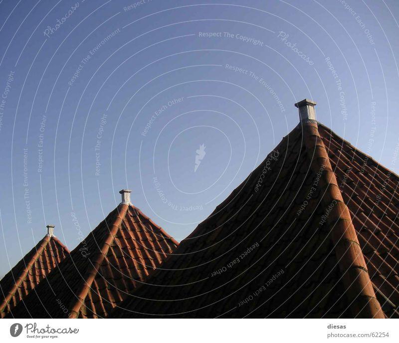 Pyramiden von Holland Haus Dach Dachziegel rot Abendsonne Reihe Schornstein Architektur