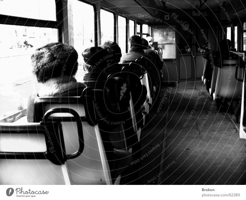 Never Alone, Just On Your Own... S-Bahn schwarz weiß Mensch Fenster Mütze trist Sitzgelegenheit Eisenbahn Einsamkeit griffe alt Reihe Alltagsfotografie Gang