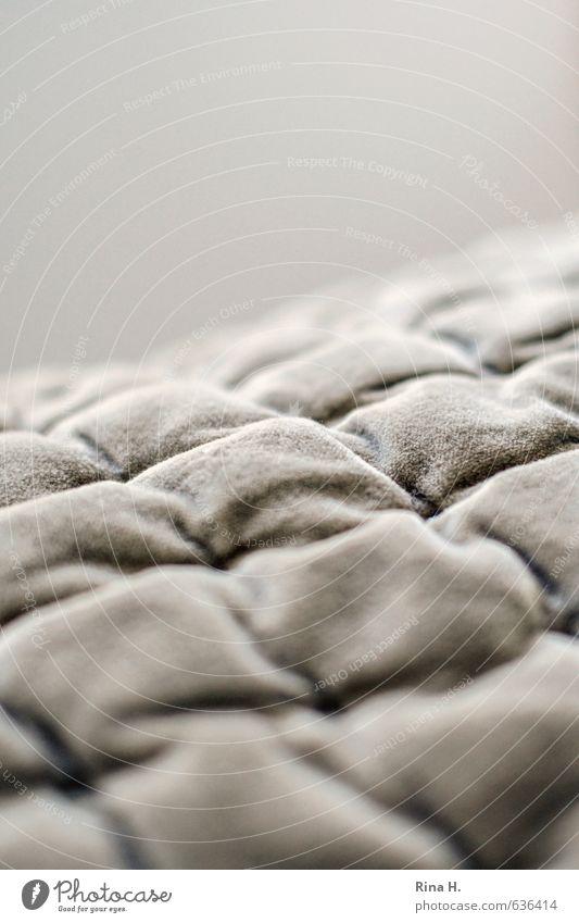 kuschelig Häusliches Leben Wärme weich Decke kariert Nahaufnahme kuschlig samtig beige gemütlich Warmherzigkeit Stoff Gedeckte Farben Innenaufnahme Menschenleer