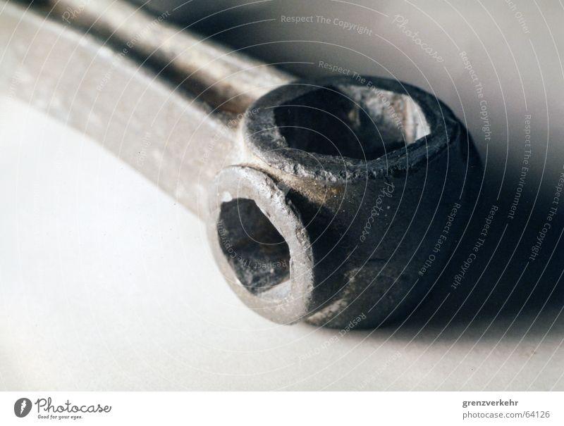 Fahrradknochen Makroaufnahme Schatten Kontrast Schwache Tiefenschärfe Arbeit & Erwerbstätigkeit Werkzeug alt Fahrradwerkzeug Knochen Werkstatt Reparatur