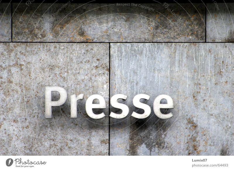 Presse Stein Metall Schriftzeichen Buchstaben Wand Printmedien Reinheit Steinwand