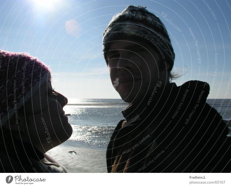 Julia und Jörg Meer Strand Winter Februar St. Peter-Ording Mütze Sonntag blenden Gegenlicht Zwinkern Liebe Licht Sonne Wasser Paar sea sun february water couple