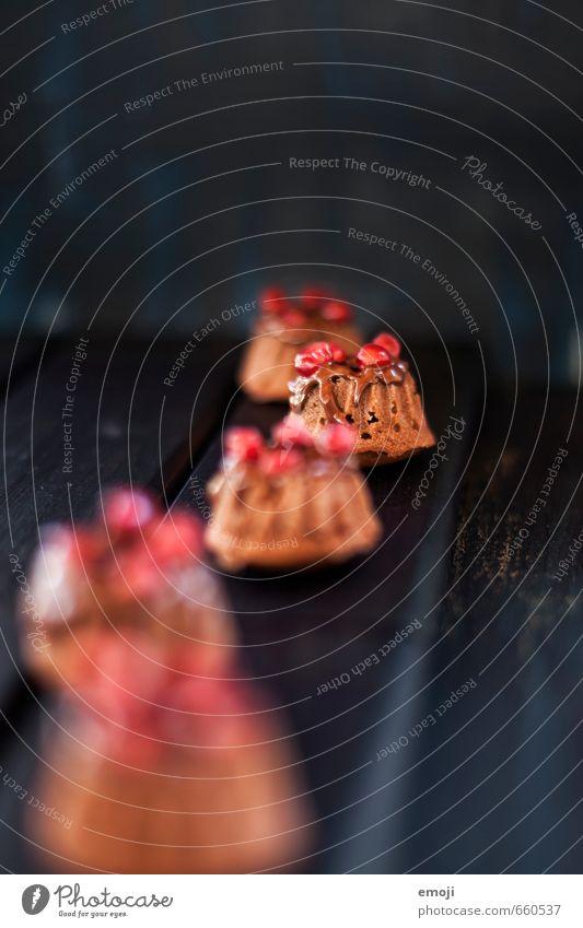 Leckerbissen Kuchen Dessert Süßwaren Schokolade Ernährung Fingerfood klein süß Kalorienreich Gugelhupf Farbfoto Innenaufnahme Nahaufnahme Menschenleer Tag