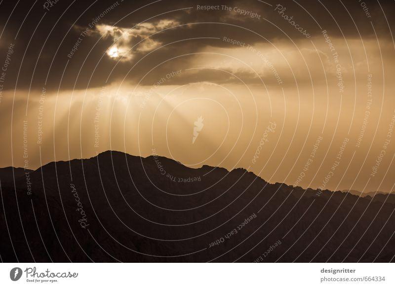 überirdisch Himmel Ferien & Urlaub & Reisen Sonne Wolken Ferne dunkel Berge u. Gebirge braun Tourismus Wetter leuchten gold hoch groß Klima Abenteuer