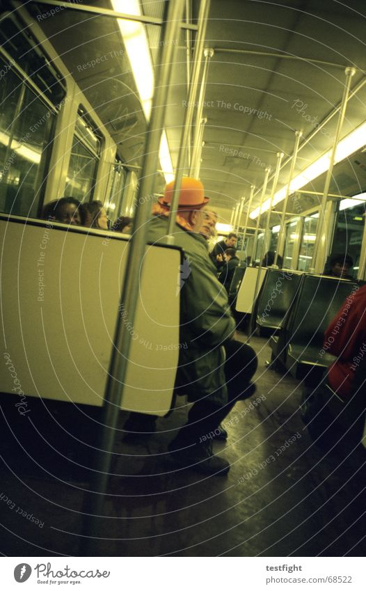 sitting in a subway to central amsterdam Mensch Beleuchtung sitzen fahren U-Bahn Mobilität London Underground unterwegs Öffentlicher Personennahverkehr
