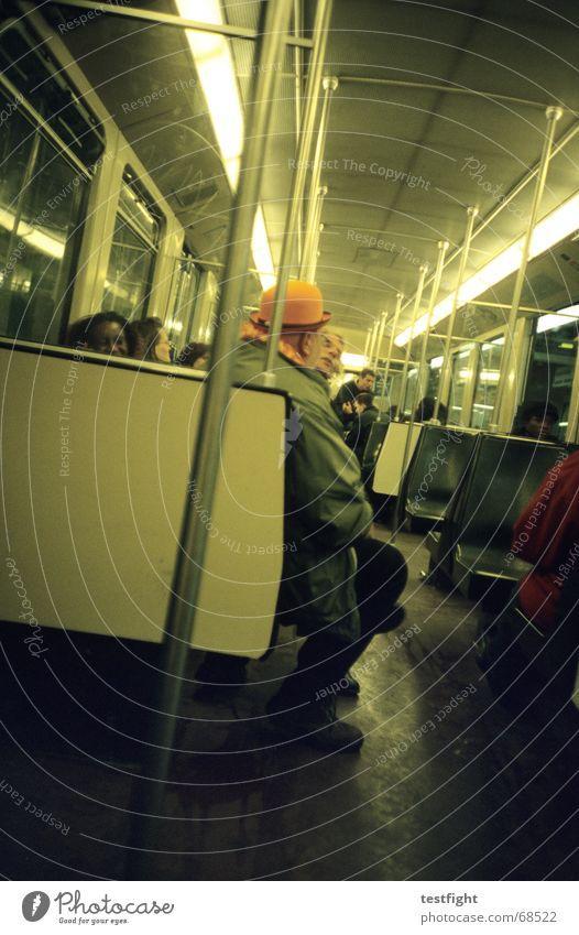 sitting in a subway to central amsterdam Mensch U-Bahn fahren sitzen Mobilität London Underground unterwegs Beleuchtung Licht Öffentlicher Personennahverkehr