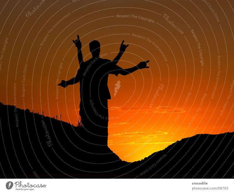 mutant bei sonnenuntergang Gegenlicht Sonnenuntergang Silhouette siluette Arme Mensch Berge u. Gebirge Abenddämmerung Himmel in flammen Kopf