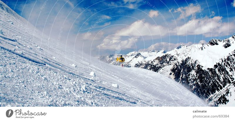 - rettung naht - Himmel Wolken Berge u. Gebirge Schnee Schönes Wetter Alpen Schneebedeckte Gipfel Skifahren Rettung Unfall Berghang Wintersport Freestyle Wolkenhimmel Hubschrauber Schneedecke