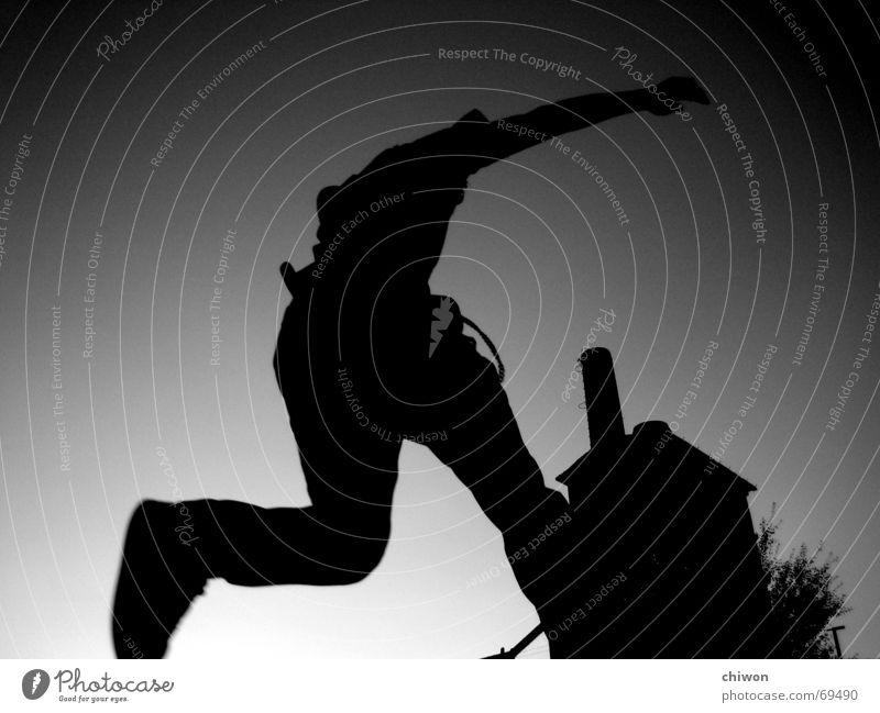 bruce spring-teen Mensch Himmel weiß schwarz Haus dunkel Freiheit springen Beine Gesundheit Arme hoch frei gefährlich Sicherheit Industriefotografie