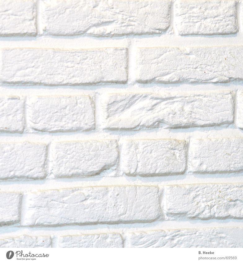 Ein Stück Wand Mauer weiß Muster hell Stein Detailaufnahme Strukturen & Formen