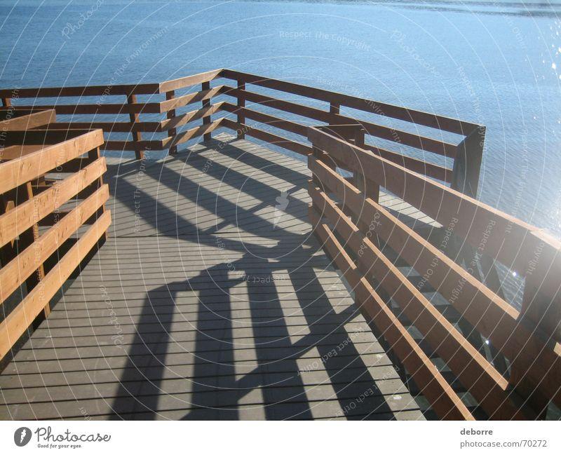 Streifenweg Wasser Meer blau Ferien & Urlaub & Reisen Erholung Holz Wege & Pfade See braun laufen Fluss