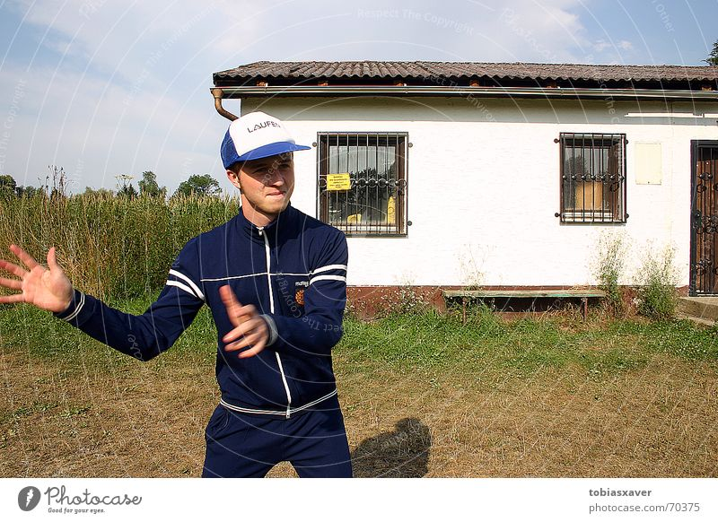 Trainer Gruber Hütte sportlich Sportbekleidung Trainer Baseballmütze Trainingsjacke