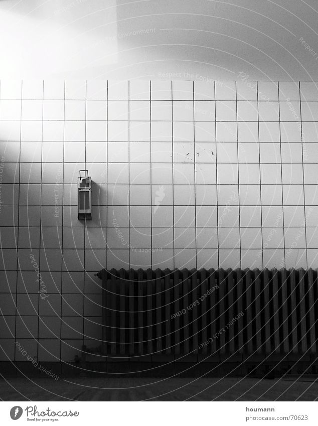 Light in cold room Licht bathroom white building light radiator dark heat soap dispenser shadow loneliness emptyness sad worn bw high contrast object Mauer