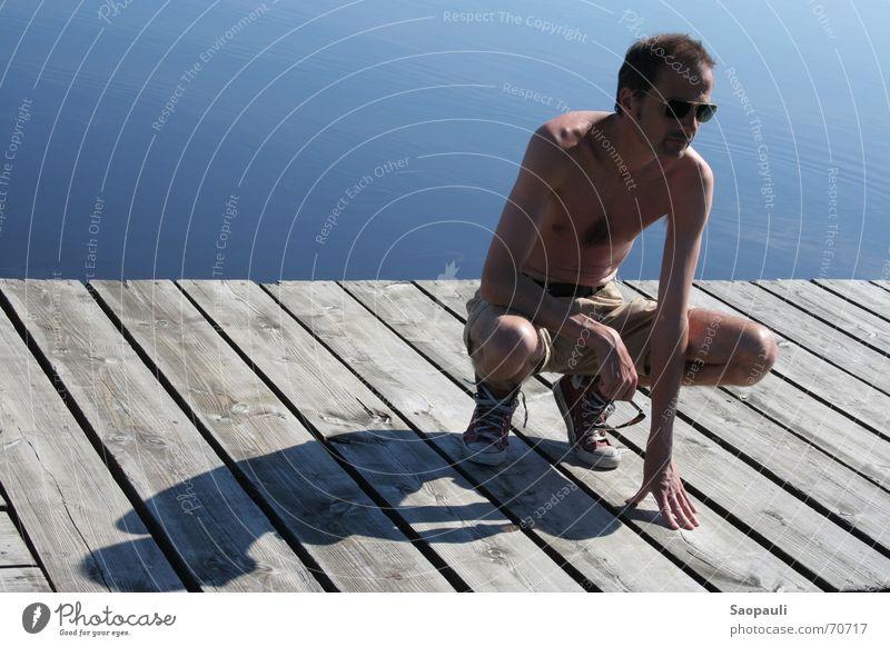 Und wo ist das Boot? Wasser blau Ferien & Urlaub & Reisen Holz Linie Konzentration Steg Symmetrie hocken Republik Irland Upper Lough Erne