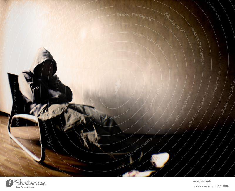 COLOUR MY LIFE | angst male mensch person sitzen sessel zimmer Mensch Mann dunkel Raum warten Lifestyle trashig Langeweile Typ anonym Textfreiraum Kapuze Sessel