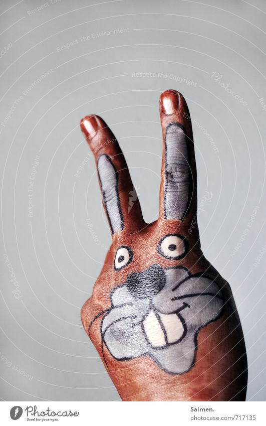 Mein Name ist HandHase Hase & Kaninchen Comic Comicfigur gemalt Kreativität gezeichnet bemalt Körpermalerei Ohr Freundlichkeit niedlich schön lustig Farbfoto