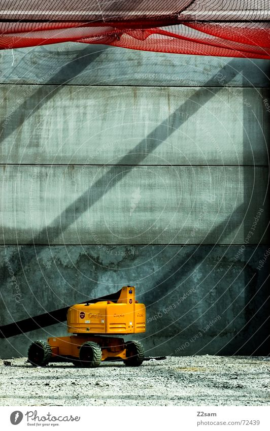 lonely machine rot gelb Netz Baustelle Fahrzeug Kies Bagger Lichtstrahl