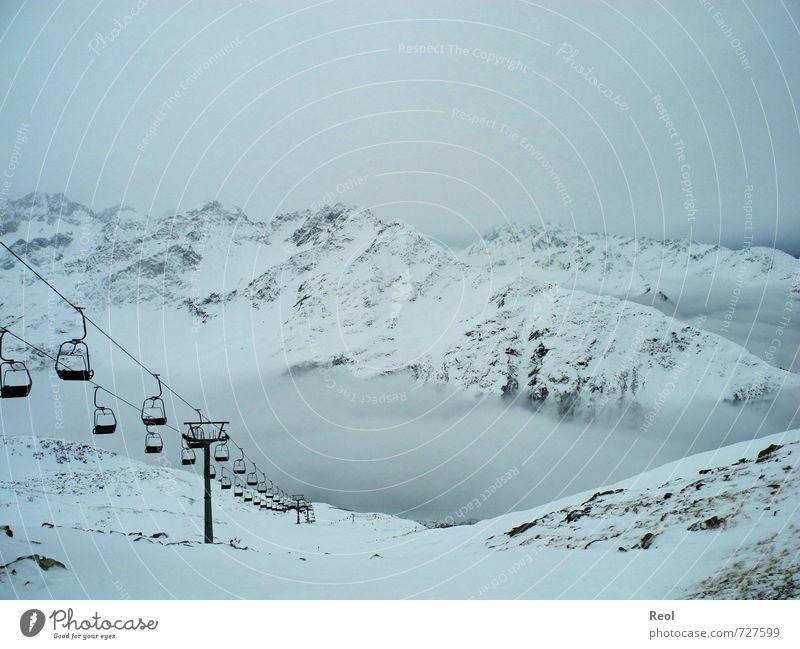 Wintervergnügen Sport Wintersport Skigebiet Skipiste Skilift Sesselbahn Urelemente Himmel Wolken Klima schlechtes Wetter Nebel Eis Frost Alpen Berge u. Gebirge
