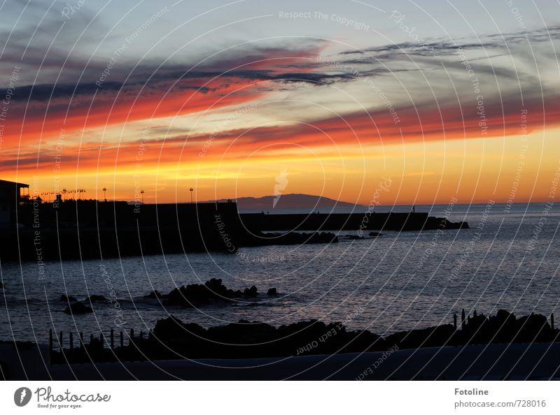 Küste von Puerto de la Cruz Himmel weiß Wasser Meer rot Wolken dunkel Wärme orange Schönes Wetter Urelemente Bucht Teneriffa Stadtmauer
