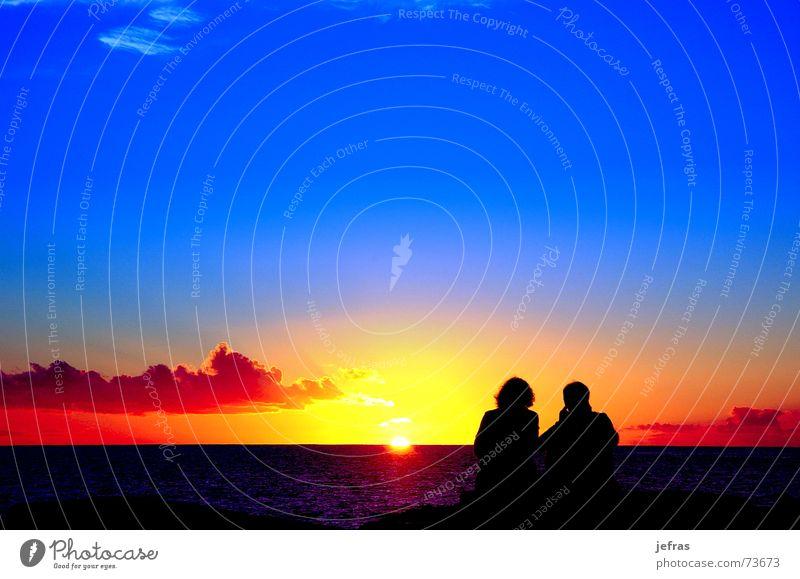 lovers to the sunset Leben Liebe Leidenschaft Mensch Himmel Sonnenuntergang Ferien & Urlaub & Reisen blue calm future landscapes men orange red sea sky Ausflug