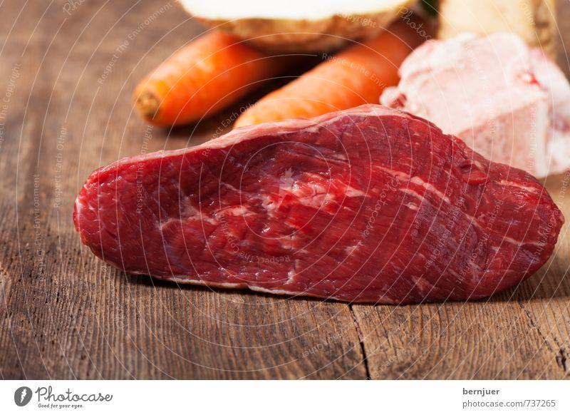 making of a Tafelspitz rot braun Lebensmittel authentisch Kochen & Garen & Backen gut Teile u. Stücke Gemüse Bioprodukte Holzbrett Fleisch Scheibe Skelett Möhre