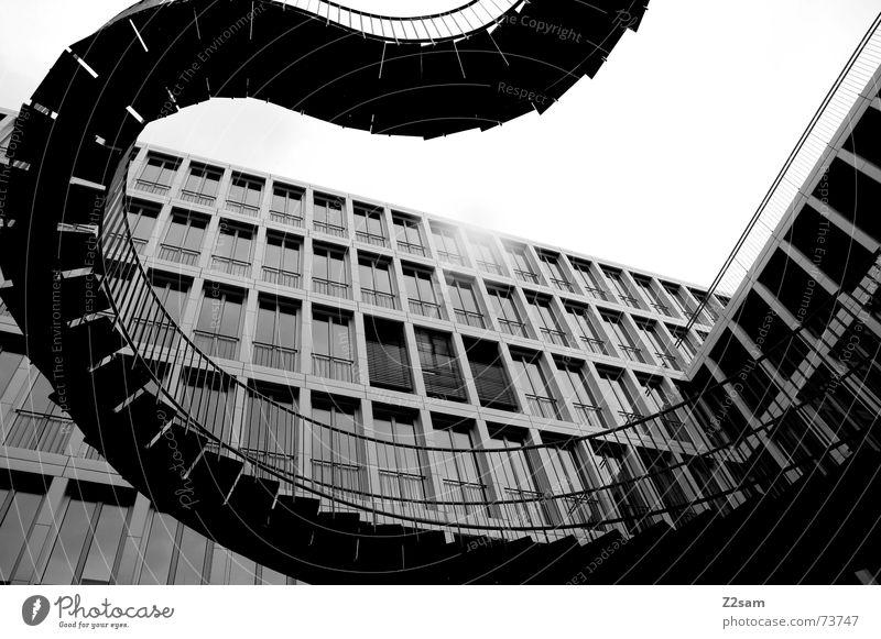 Treppenschlange ins Nichts Haus Kunstwerk architecture Bauernhof modern stairs Geländer Leiter Schwarzweißfoto Strukturen & Formen schlangenförmig Architektur